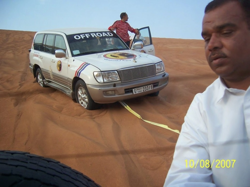Our driver helping his fellow driver to jump start his vehicle in the desert
