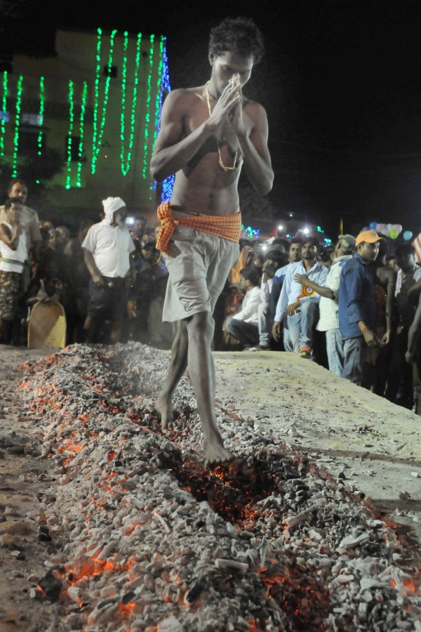 Manda Festival: A devotee is walking on burning coals