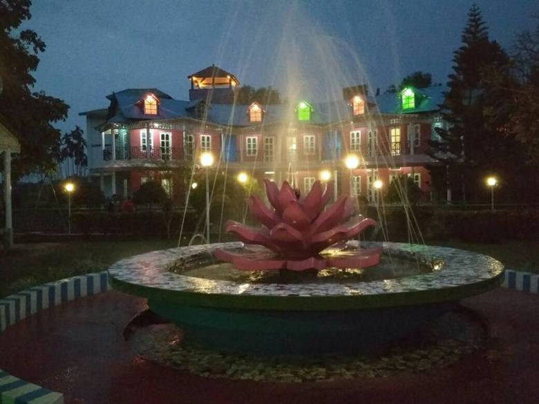 The beautiful fountain lit in night at the Sonar Bangla Resort, Lataguri, Jalpaiguri district, West Bengal