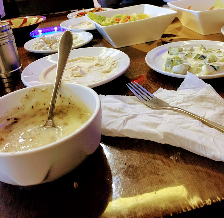 A collection of salads, soup and breads served before meal at any Iraqi restaurant