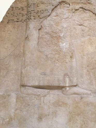 A stone relief of King Ashurbanipal, National Museum of Iraq, Baghdad.
