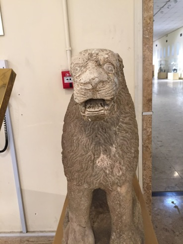 Statues of lions sitting on the base were used to decorate with sides of the main entrance in the court temple to worship Goddess Ishtar in the city of Hatra, dated to Hellenistic period (312-139 BCE), National Museum of Iraq, Baghdad.