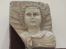 A slab stone of Alabaster with a prominent relief of the Sun God (Shamash), found in the city of Hatra (312-139 BCE), National Museum of Iraq, Baghdad.