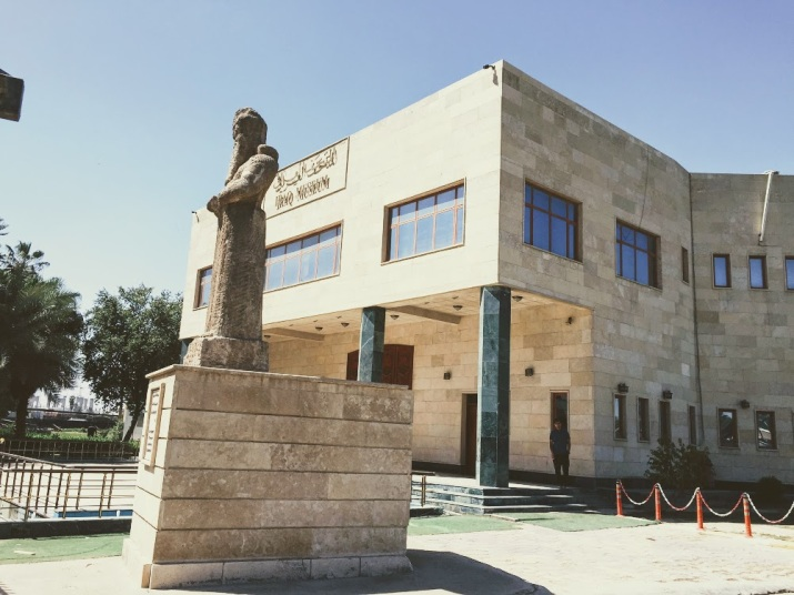 A statue of Nabu, the 8th century BCE Assyrian god of wisdom, stands before the building of the Iraq Museum.