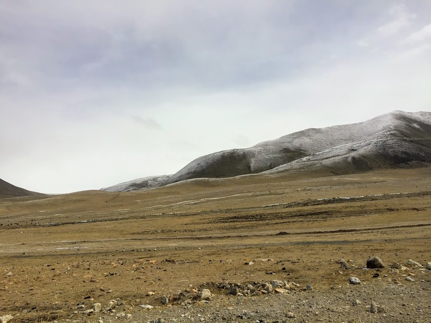 The land resembles Tibetan plateau and the road is through a stony moraine-like unpaved path.