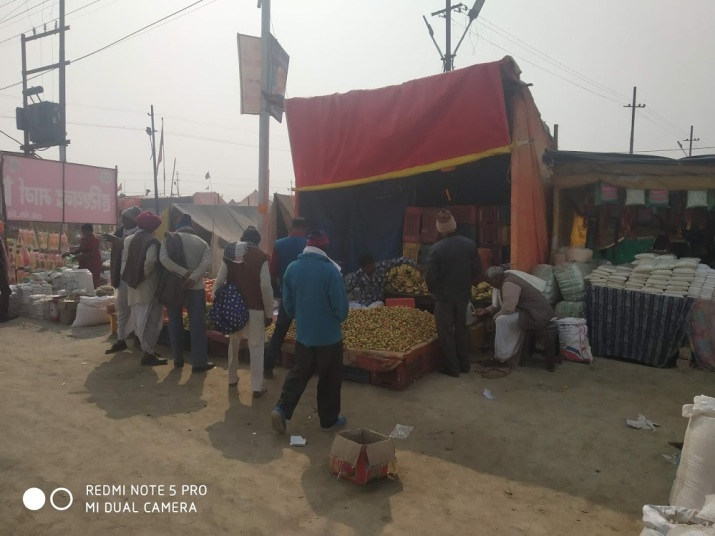 Shops selling fruits and groceries for the devotees staying in the Tent city — Kumbh Nagri