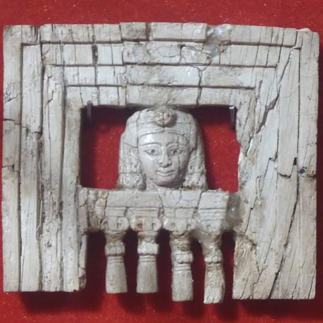 ivory plaque from Iraqi Museum, Baghdad illustrating a woman at a window